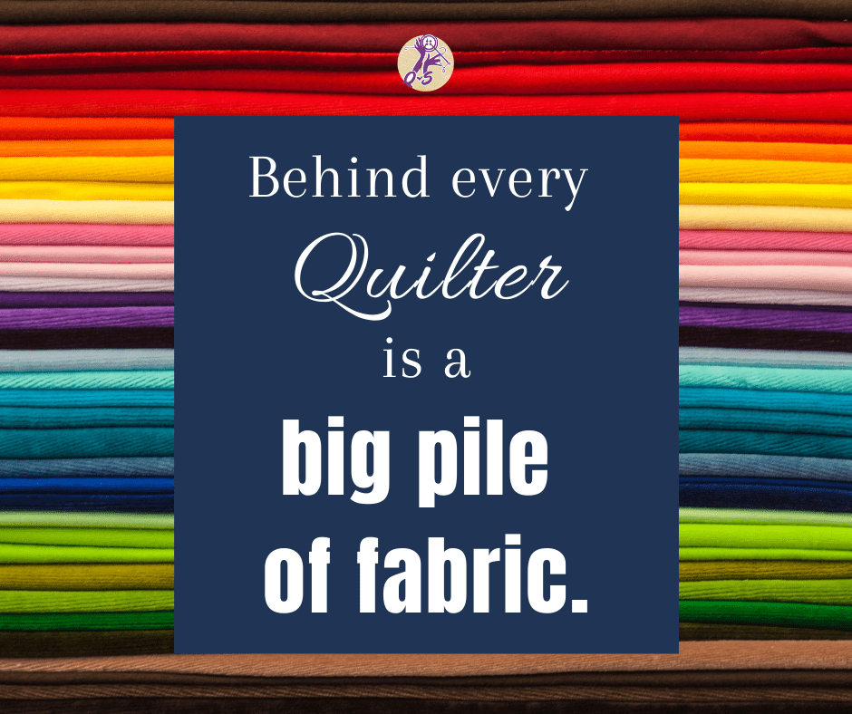 behind every quilter is a big pile of fabric